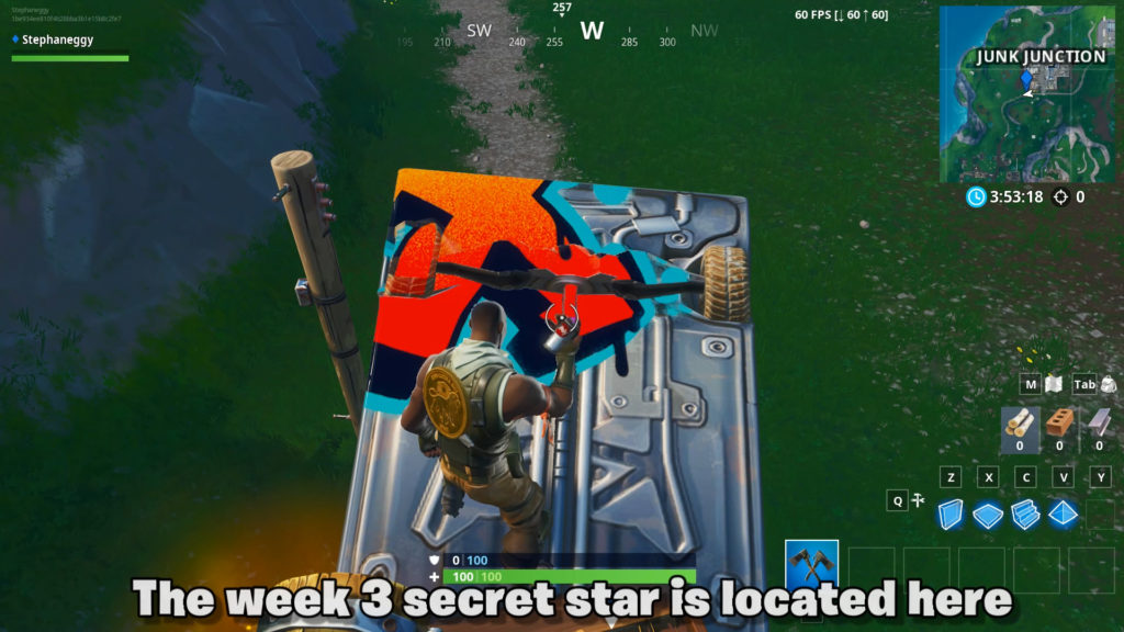 The week 3 secret star is located on top of the pile of trucks